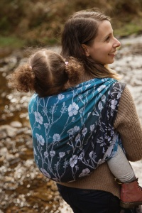 Entwistle Reservoir - picture of a mum carrying her toddler on her back in a Baie Slings carrier next to a stream