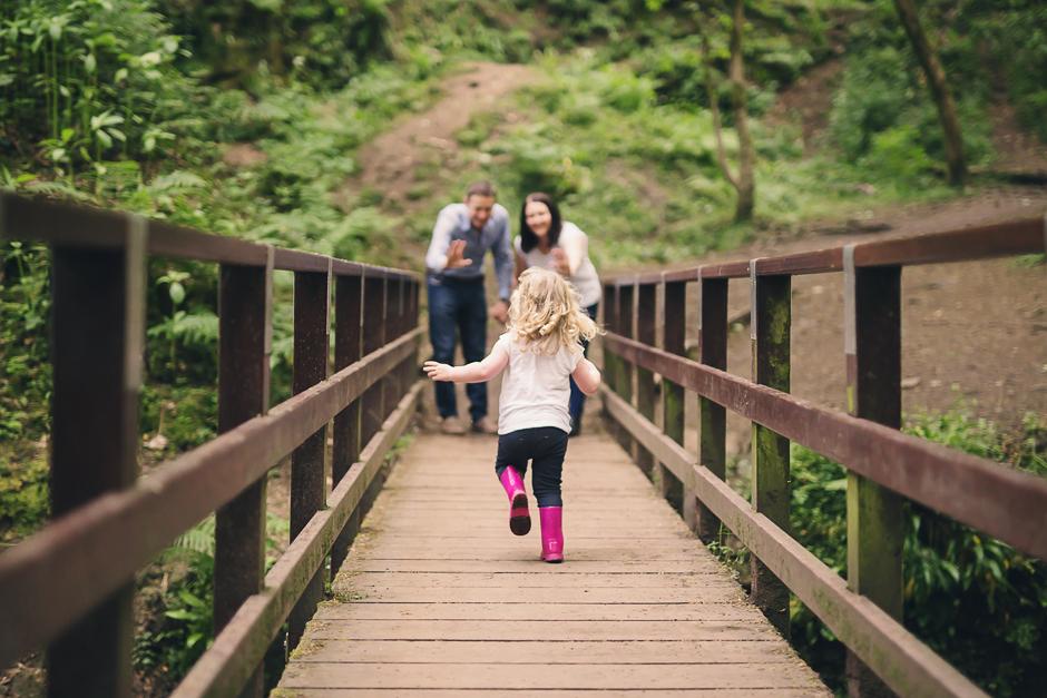 Appley Bridge Wigan - Toddler running across a bridge towards her parents