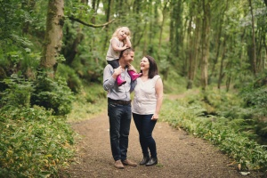 Appley Bridge Wigan - Mum and dad with toddler on his shoulders, standing together