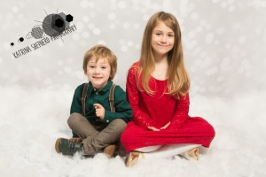 Christmas mini photo shoot blackburn - Two Children sitting together
