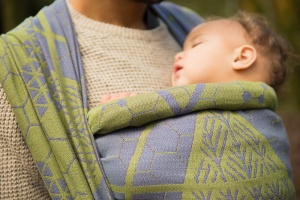 Sunnyhurst Woods Darwen - Close up of a baby girl alseep in a Firespiral Slings wrap
