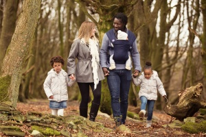 Roddlesworth Woods Tockholes - A family of five walk through the woods laughing and talking with each other