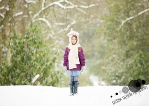 Bold Venture Park, Darwen - A girl stands in the woods surrounded by falling snow