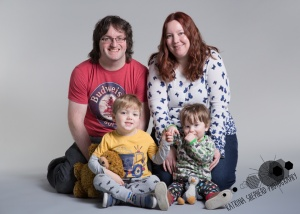 Happy Daze, Darwen - Mum and dad sit behind two brothers holding hands